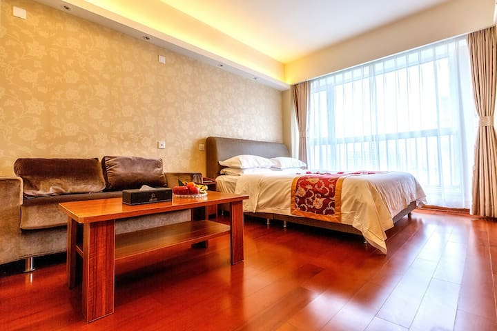 青岛深蓝假日度假式公寓--豪华商务大床房 - Qingdao