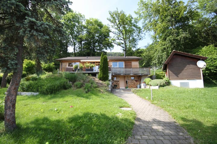 Wooden house surrounded by nature near Basel - Movelier