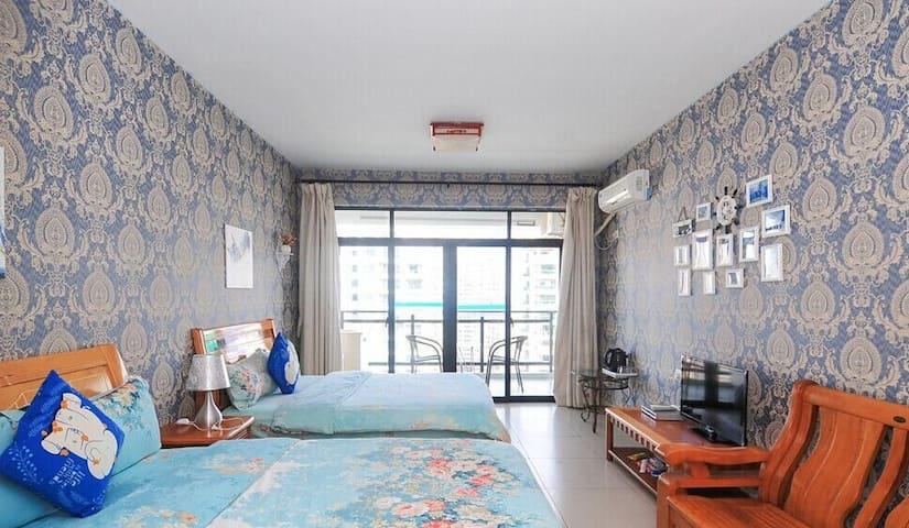 三亚湾 在路上 海景双床房 两张1.5m大床48平方   4晚免费接机 - Sanya - Wohnung