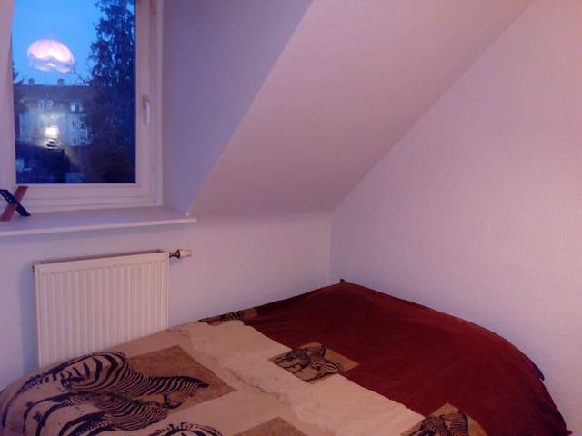 Une chambre dans un appartement F2 - 米盧斯(Mulhouse)