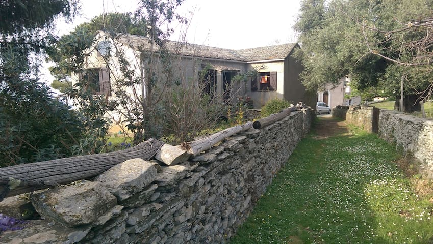 Corsican cottage and gardens with sea view. - Canari