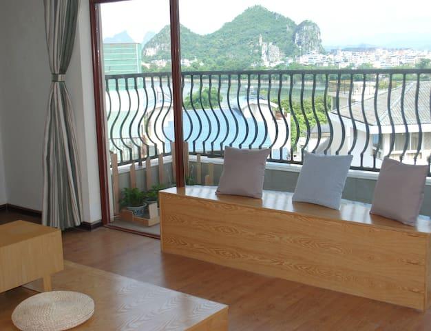 在桂林可看漓江、看山景的安静旅舍,简约独立房间(大床间) - Guilin - Apartemen