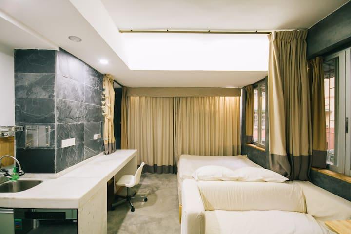 步行至江南西地铁站仅5分钟,方便搭高铁,安静花园小区,简约现代居室 - Guangzhou - Leilighet