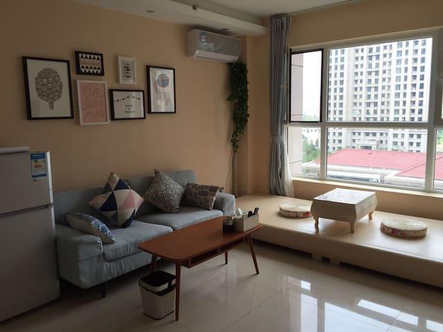 动静相宜安全舒适卫生高级五星级度假公寓 - Yantai - Lägenhet