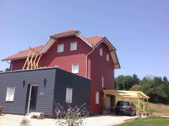 Canapé lit dans maison écologique - Grandfontaine  - Huis