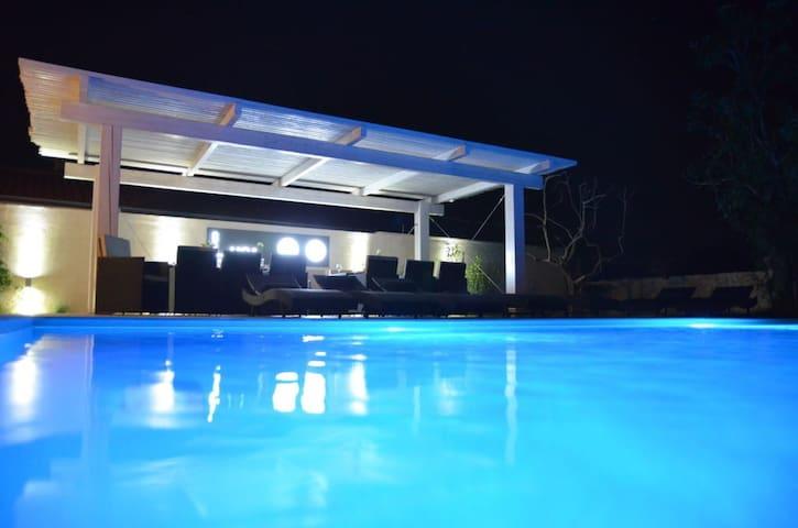 White apartment with swimming pool - Nin