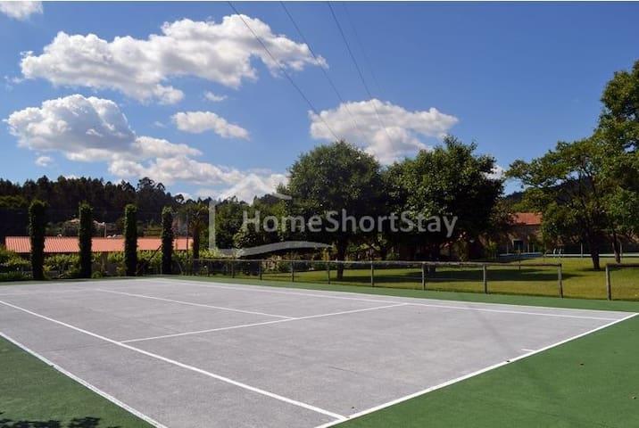 Casa de férias em complexo com piscina e tenis - Grimancelos - Stadswoning