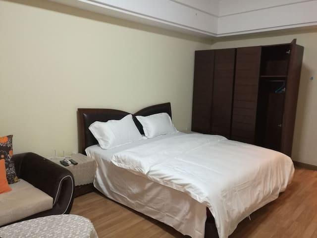 万达市中心尊享大床房 - Zhenjiang - Apartmen