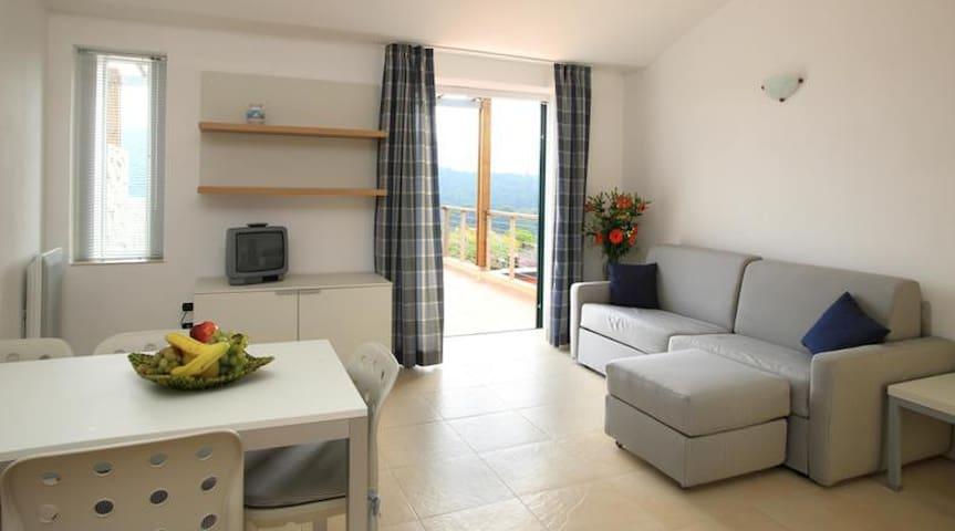 Bilocale con terrazza vista mare - Acquabona - Wohnung