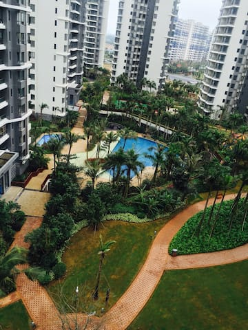 西海岸别墅花园小区一室一厅带泳池蓝球场儿童娱乐设施,环境优美温馨舒适 - Haikou Shi