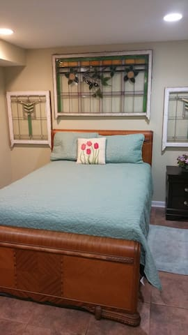 Bedroom with bath and large family room. - Chicago